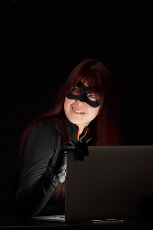 Girl in mask with laptop