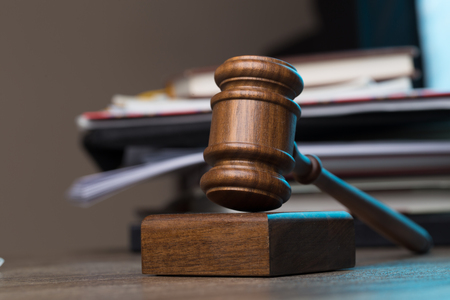 Judges hammer lies on table Stock Photo