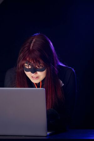 mugger: Mugger woman in black mask Stock Photo
