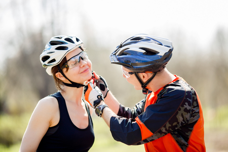 Cyclists in helmets at park Stock Photo