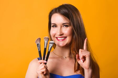 beautify: Beautiful woman with makeup brushes