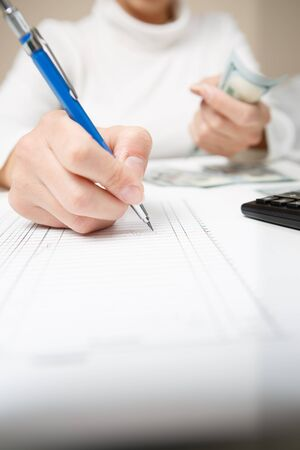 economic forecast: Entrepreneur calculating and reviewing investment plan Stock Photo
