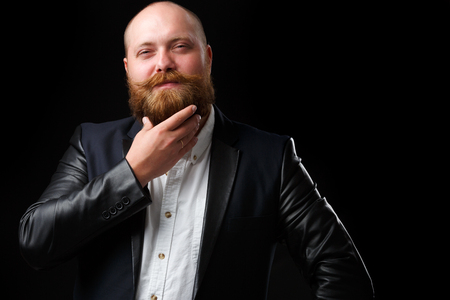 Man stroking his ginger beard Stock Photo