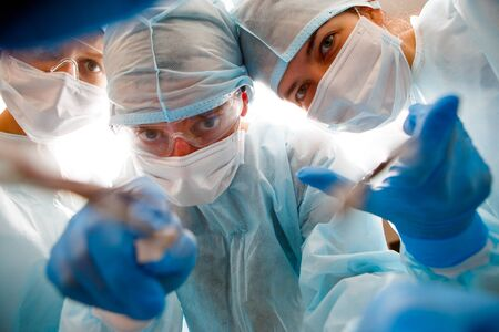 Surgeons holding instruments in hands Stock Photo