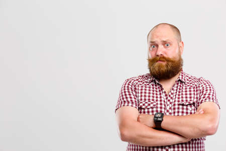 bewildered: Bewildered man with ginger beard Stock Photo