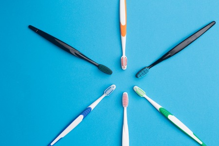 Multi-colored toothbrushes arranged in circle