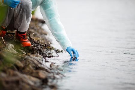 Laboratory assistant takes water samples Reklamní fotografie