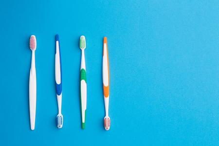 single word: Multicolored toothbrushes with blank space Stock Photo