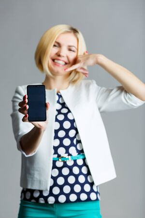Girl with smartphone in hand Stock Photo