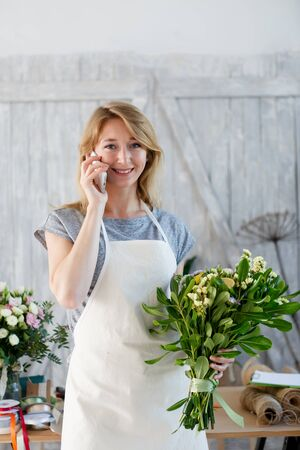 clothing store: Florist with phone and bouquet