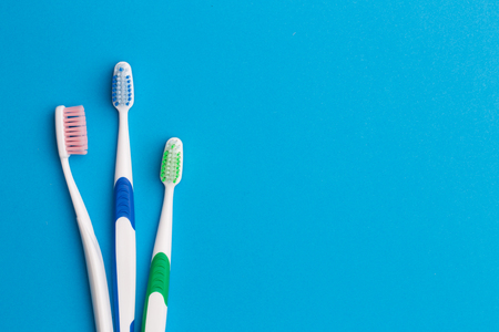 Colorful toothbrushes, place for inscription Stock Photo