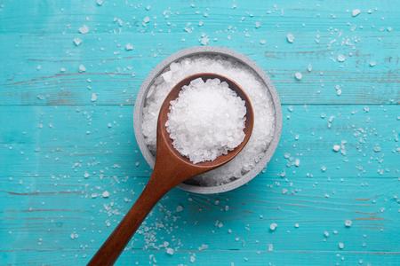 sea salt in stone bowl and wooden spoon 版權商用圖片