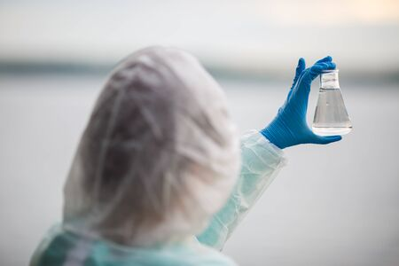 groundwater: Photo lab assistant from back Stock Photo