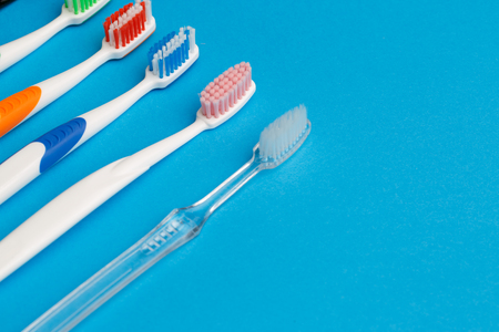 Colored toothbrushes , place for inscription