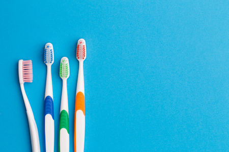 Multi-colored toothbrushes, space for text