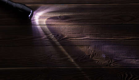painted wood: Wooden background with glowing flashlight Stock Photo