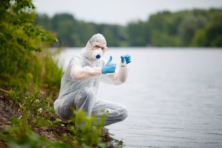 groundwater: Ecologist in respirator with bulb