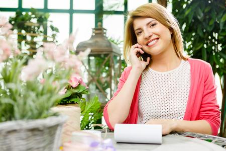 Happy florist in flower shop Stock Photo