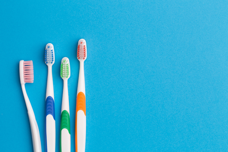 Colorful toothbrushes, space for text