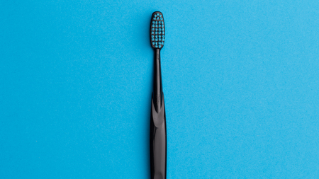 Photo of one black toothbrush Stock Photo