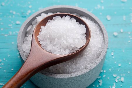 sea salt in stone bowl and wooden spoon Stock Photo
