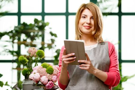 Florist with tablet in hands Stock Photo