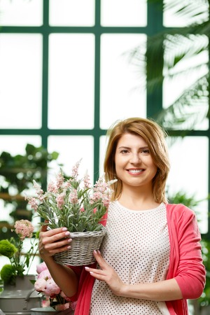 Woman with flower in pot Stock Photo