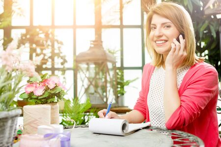 Smiling florist in flower shop Stock Photo