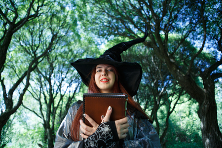 Photo of witch in black hat Stock Photo