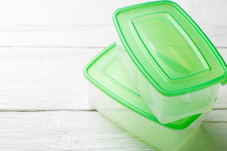 Image of two containers with green lid