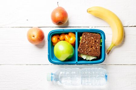 is green: Photo of sports useful snack in lunchbox