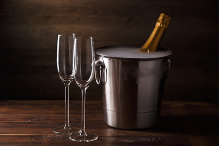 Picture of two empty wine glasses, iron bucket