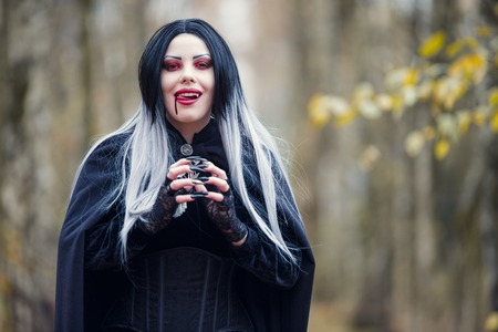 Image of vampire woman with trickle of blood at mouth Standard-Bild
