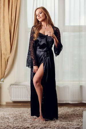 Picture of long-haired woman in black negligee