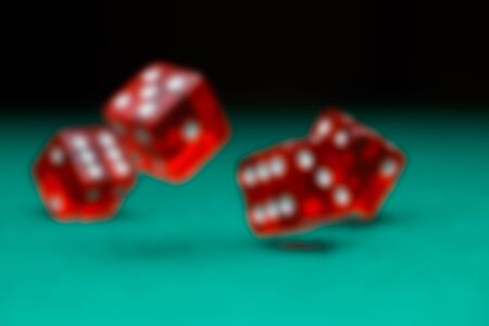 Picture of dice falling on green table