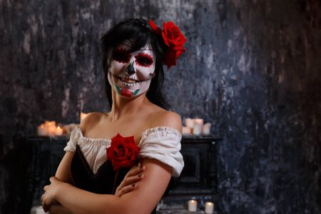 Halloween picture of smiling zombie woman with makeup Stock Photo