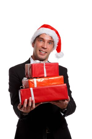 Christmas picture of happy man in business suit, Santa cap with gifts in boxes