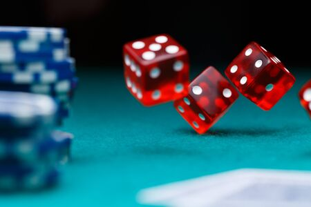 Photo of dice, chips in casino on green table Stock Photo