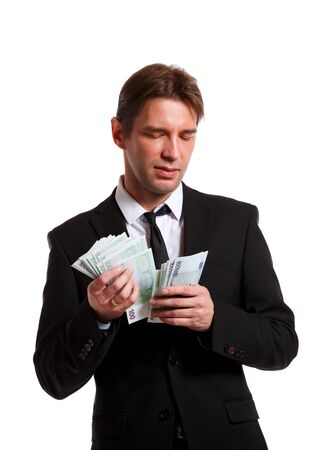 Photo of businessman in suit with euro in hands Stock Photo
