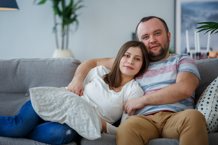 Image Of Cuddling Lovers On Gray Sofa Stock Photo   95513558