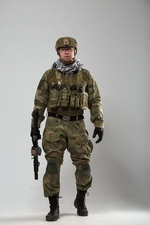 Full-length image of soldier with gun in his hand Stock Photo