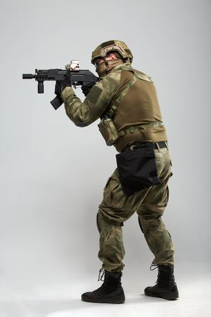 Image of aiming military man with gun Stock Photo