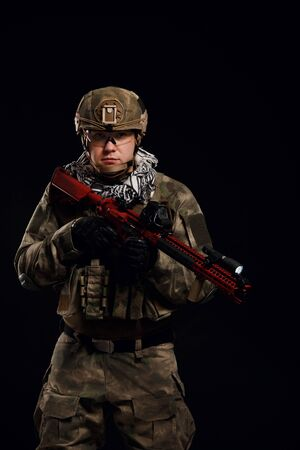 Portrait of soldier with arms Stock Photo