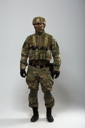 Photo of military man in camouflage