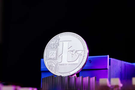 Picture of litecoin and processor on pink background Stock Photo