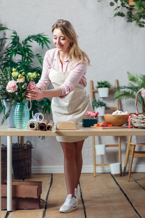 Image of florist woman making composition of flowers Stock fotó