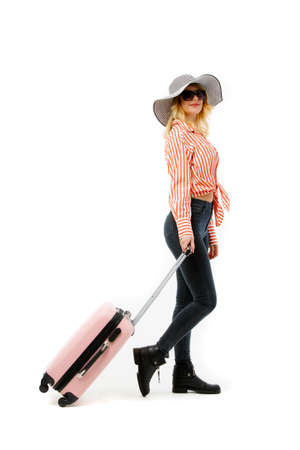 Photo of blonde in hat with suitcase isolated