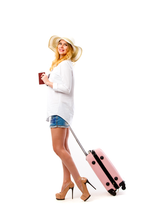 Photo of blonde in hat with suitcase, passport