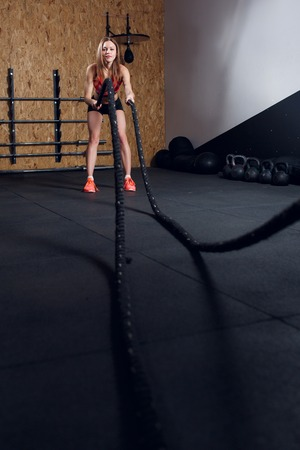 Image of young athlete girl in training with two ropes Stock Photo
