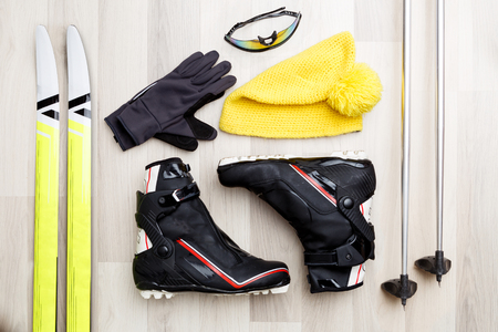 Photo of skis, sticks, caps, glasses, shoes